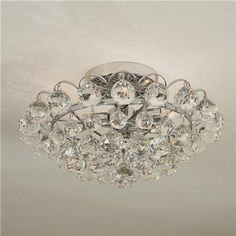 Glam it up with this gorgeous flush-mount light fixture.  Good when you don't have tall enough ceilings for a chandelier.
