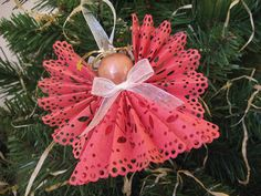 Angel Christmas Ornament Dark Pink Paper Lace Ribbon Angel Ornament. $4.00, via Etsy.