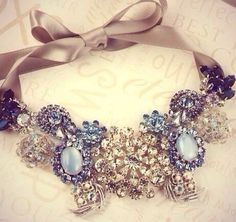 This can be made from a couple of brooches or earrings pinned to a ribbon.