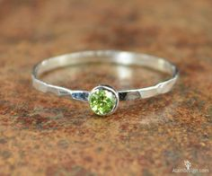 These dainty rings make such a stunning fashion statement! This thin silver band is set with a dainty 3mm Peridot Green conflict free cubic zircon - August's birthstone! These rings are beautifully wo