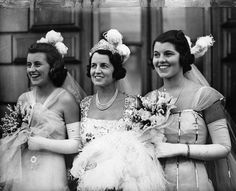 Rose Kennedy (center) with her daughters Kathleen and Rosemary when they were presented to King George VI and Queen Elizabeth in 1938.
