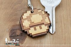 Laser cut and engraved Mario Bros 8bit 1up wood keyring. By TwikiConcept on Etsy