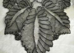 Lovely fine and light hand French Chantilly lappet or tie, dating to the mid century. Lavish and imaginative composition of the botanical leaf and foliage design elements. In excellent antique condition and measures long and wide at the widest