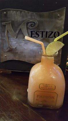 Frozen Perfect Patron Rose and Blood Orange Margarita at Mestizo Restaurant. Mexican Cocktails, Blood Orange Margarita, Tequila, Decorative Bells, Whiskey Bottle, Frozen, Restaurant, Drinks, Modern