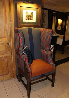 Ostrich leather ,tartan and distressed denim wing chair in one of our Junior suite at Le Loft de Bamako.