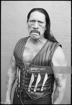 Actor Danny Trejo poses for the Machete movie premiere in an alley behind the Orpheum Theatre Downtown Los Angeles 2010.
