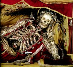 """The adorned remains of Saint Felix, once of the parish of Tafers, Switzerland now on exhibit at the Museum of Art and History in Fribourg, from """"Heavenly Bodies: Cult Treasures & Spectacular Saints from the Catacombs"""" by Paul Koudounaris"""