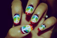 Rainbow peace nails.