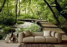 Effective wall and room design with photo wallpaper- Effektvolle Wand- und Raumgestaltung mit Fototapete Living room wall design with a wooden path and river in the forest as an accent wall behind a sofa beige, room decoration with three glass vases - Living Room Wall Wallpaper, Wood Wallpaper, Custom Wallpaper, Photo Wallpaper, Wallpaper Murals, Wallpaper Designs, Wallpaper Ideas, Living Room Wall Designs, 3d Living Room