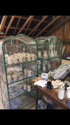 Great idea to use portable greenhouse in pottery studio