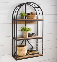 Our Deep Creek Arched Wall Shelf makes an impressive statement while displaying your favorite decorative items, small plants books and more. This graceful shelf is a rustic delight crafted of recycled wood on a sturdy metal frame. The beautifully distressed pinewood shelves have handsome variations in tone and texture for a gorgeous look. The wrought iron frame features a rustic finish and twisted accents for added style. You'll love the versatility and function of this attracti Wall Shelf Display, Pine Shelves, Metal Arch, Family Room Furniture, Recycled Wood, Metal Wall Shelves, Indoor Furniture, Decorative Items, Wood And Metal