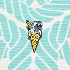 """Wipe Out! Whether you're surfing the waves or just enjoying a scoop, this pin has summer written all over it! • 1.5"""" Hard enamel • Design by Luke Day"""