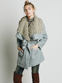 Cozy Belted Wrap Coat | Stay chic in this super cozy and warm belted wrap coat featuring a fuzzy contrast lining on the lapel.  Slip pockets.