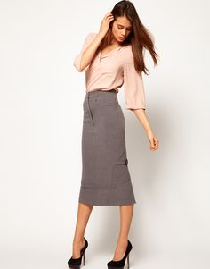 ASOS Midi Pencil Skirt With Buckles- wear with a slim knit turtleneck, boxy hip-length coat, bare legs, and classic pumps