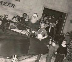 Marilyn Monroe helping Santa with the kids.