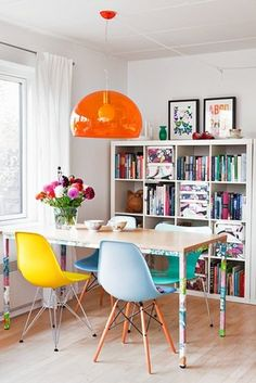 dream home | dining room | bookshelf storage + colorful mismatched chairs