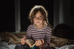 rim light lifestyle portrait photography of a girl with a book by Anita Perminova