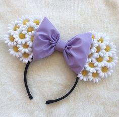 handmade daisy duck inspired floral ears made with white daisy flowers and finished off with a lavender bow