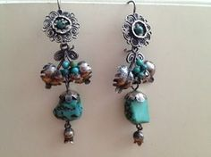 Beautiful turquoise earrings with silver leaves. Turquoise on bottom is 30 years old.
