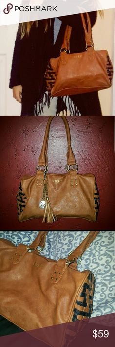ROXY Leather weaved bag/purse Beautiful Roxy bag! No long strap. Comes with Roxy charm and tassel. Leather like. Very roomy. Zipper zips into sides. Inside zipper pocket. And 2 open pockets.  Great condition! You will love! Roxy Bags Hobos