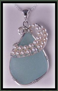 Pendant made with aqua pastel sea glass found on New England coast line. I just love the pearl flourish around the sea glass.