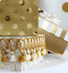 gold vintage trim around boxed Christmas presents