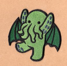 (PLEASE READ the note on the front page of my shop for important info/updates before you order.)  Cute Cthulu embroidered patch. Design by