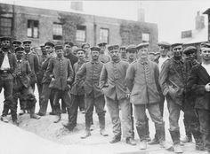 HOME FRONT 1914 - 1918 (HU 53371)   Prisoners of War and Refugees: A group of German prisoners, some wearing uniforms, others an assortment of dress, standing about in the camp at Dorchester. Some of the prisoners were taken during the Battle of the Somme.