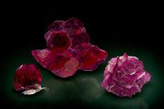 Synthetic Corundum grown by the flux method, (left) Chatham ruby on platinum sheet, 2.5 cm, Chatham Inc.; (center) Ramaura ruby, 6.2 cm, J.O. Crystal Company; (right) Kashan ruby, 4.0 cm, Ardon Associates Inc. Photo by Joe Budd