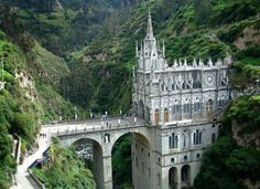 Las Lajas Cathedral – Kolumbien  Look at how cool this place looks! Perched all majestic-like up on that wall of rock and tree.