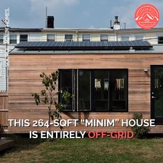 This Minim House is entirely off-grid, featuring a functional, open floor plan great for entertaining; modern kitchen with a huge window; a large living space with a rollaway bed Off Grid Tiny House, Best Tiny House, Tiny House Cabin, Tiny House Living, Tiny House On Wheels, Living Room, Living Spaces, Container House Design, Tiny House Design