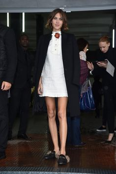 Pin for Later: The Stars Are Looking Quite Stylish Over in Milan Alexa Chung Alexa's simple white cotton dress stood out in the crowd thanks to the floral add-on and furry shoes.
