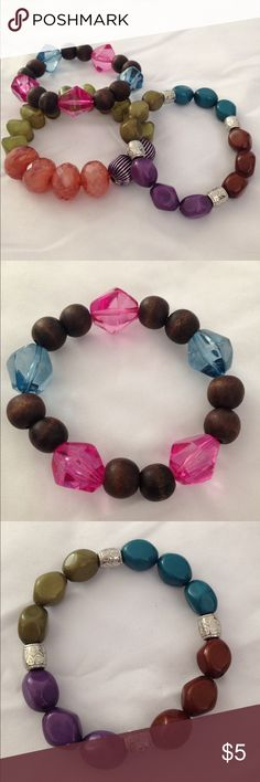 Charlotte Russe 3 beaded colorful bracelets These thick beaded bracelets are beautiful wear alone or stacked together. An elastic band, fits most people. Orange, green, blue, pink, purple and brown Charlotte Russe Jewelry Bracelets