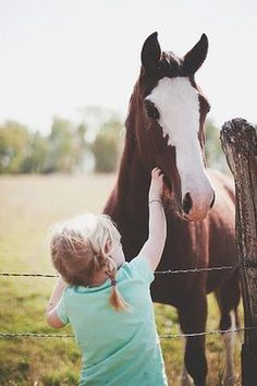 Just a country girl and her horse. so cute- I want my kids to grow up around horses (: