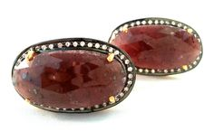 Natural pink sapphire faceted cabochons set in sterling silver . Encircled with zircons. Mynahs Tree, India.