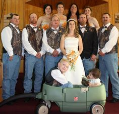 groomsmen and groom with camo vests jeans and belt buckle