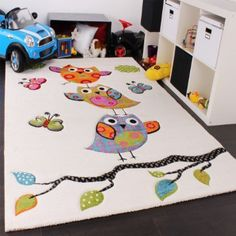 owl rug, just slightly off-white with pink, blue, green, orange.  Kinder Teppich Niedliche Eulen Creme Blau Orange Grün, Grösse:120x170 cm: Amazon.de: Küche & Haushalt