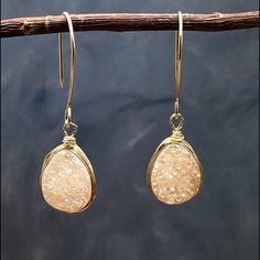 HP Blush Druzy Earrings Host PickTear drop Druzy in blush on a 14k gold filled hooks wire wrapped in a 14k gold filled wire. These are contemporary super trendy. Dress it up or down. Color is soft peach blush. Wear it everyday with just about anything. Approximate length 1.9 inches. Matana handmade jewelry. Matana Jewelry Earrings