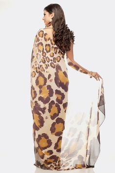 A beautiful bold printed saree with scattered leopard pattern worn with a brown blouse matching the pallu.Shop online at www.satyapaul.com and Join our facebook page at www.facebook.com/SatyaPaulIndia