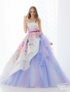 This Hardy Amies London bridal gown featuring watercolor floral patterns and lavender tulle skirt is a dreamy show stopper! View post: www.praisewedding.com/community/watercolorlavender