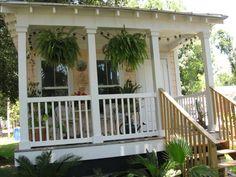 Lovely peach Katrina Cottage.