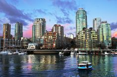 see the beautiful vancouver skyline at dusk from a water taxi to granville island