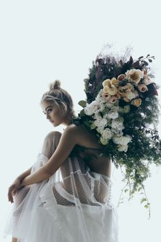 » bohemian wedding » floral crown » boho wedding dresses » feather bouquet » gatherings » elements of bohemia »