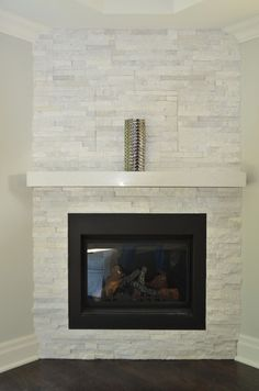 White Stone Corner Fireplace Design Contemporary Don't have the full for a full-scale fireplace? Discover the top 70 best corner fireplace designs featuring luxury angled interior ideas and inspiration. Corner Fireplace Living Room, Home Fireplace, Fireplace Tile Surround, Fireplace Design, Living Room With Fireplace, Airstone Fireplace, Basement Fireplace, Corner Gas Fireplace, White Fireplace