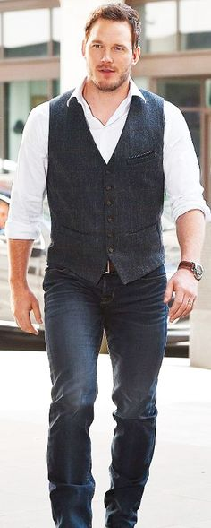 Digging the vest and jeans combo.