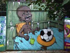 Comienza el mundial de fútbol 2014, bien pero... Fotografía. El autor es Paulo Ito. Hizo este dibujo en la entrada de una escuela pública de Sao Paulo, en Brasil. @Educo_ONG