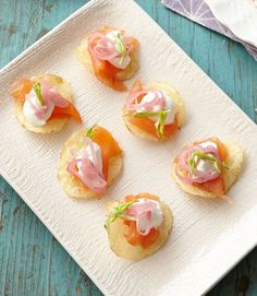 These small bites are loaded with flavor: smoked salmon, pickled shallots, and tarragon.