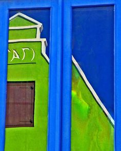 Don't adjust your monitor — this is a photo of a reflection in a window. Don't be surprised… Curacao is one colorful island.