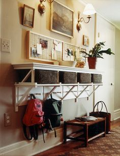 This set up is great for families with children because the pegs are at the perfect height. The upper shelf serves as the adult space, with cork boards for hanging important reminders.