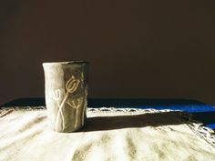 """ceramic cup with white floral pattern by our local art studio """"Quiet Form"""" (clay, angob, glaze)"""
